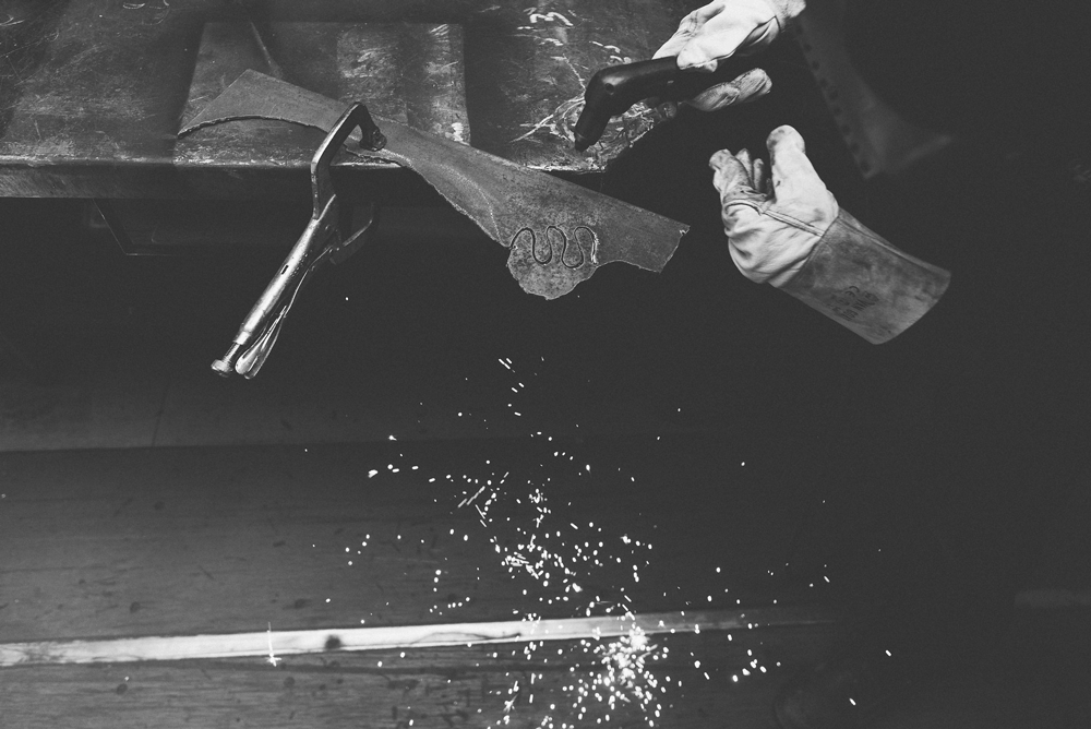 Art welding in shop black and white